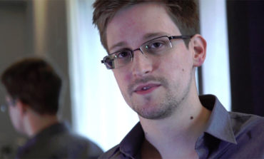Stranded fugitive Snowden seeks temporary asylum in Russia