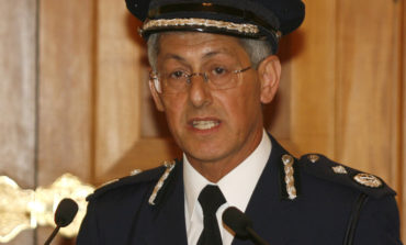 Former top cop sues president