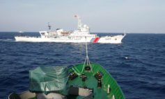 China vows to protect South China Sea sovereignty, Manila upbeat