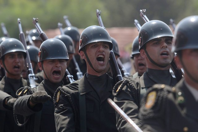 Turkish soldiers take part in a parade on Wednesday to mark the invasion