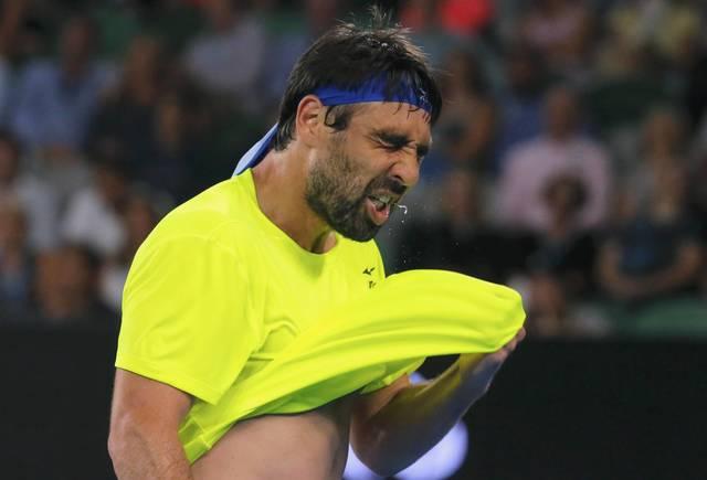 Baghdatis out, Nadal delayed in Madrid
