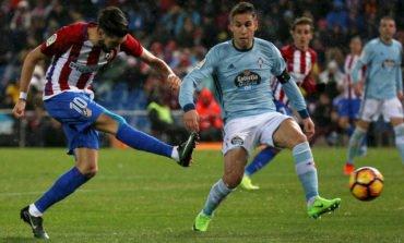 Sevilla sneak past Las Palmas to stay in title race