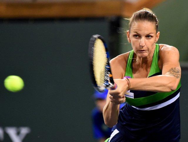 Pliskova rallies past Puig to avoid Indian Wells upset