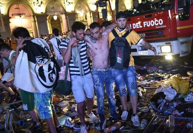 Hundreds of Juventus fans injured in stampede in Turin