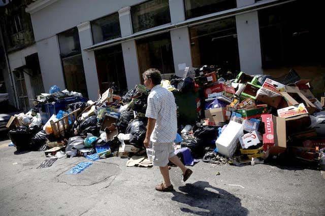 Rubbish piles raise health fears in strike-hit Greece