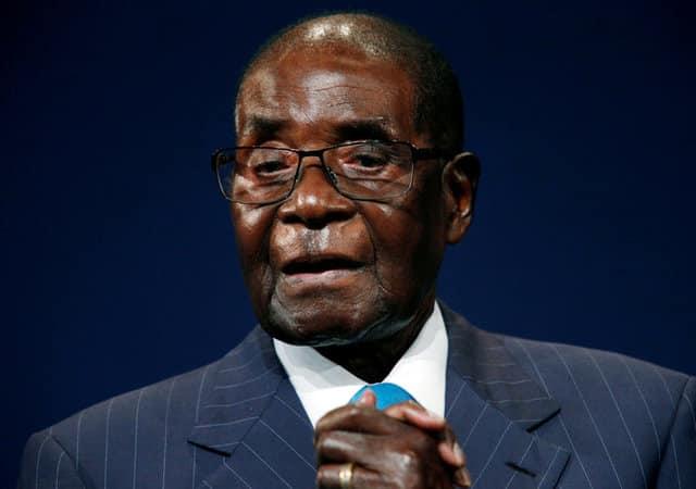 Mugabe says not going anywhere, not dying