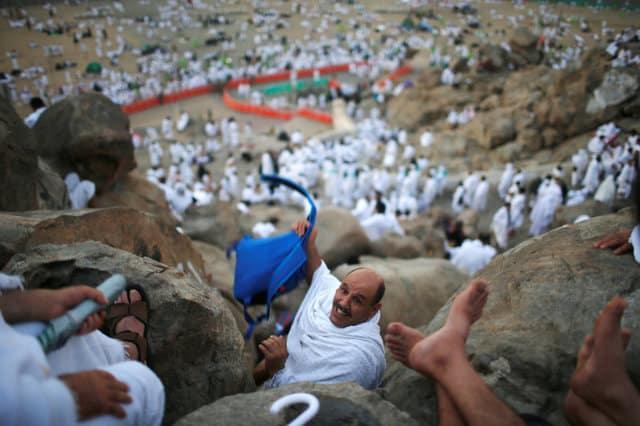 Muslim pilgrims gather on Mount Arafat for haj climax