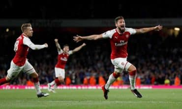 Giroud header seals Arsenal win in season opening thriller
