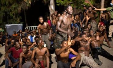 Dozens of migrants run across border in Spanish enclave