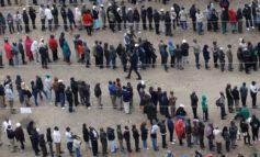 Jittery Kenyans vote in Odinga's last bid for presidency