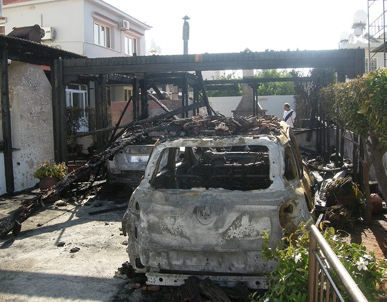 Arson destroys two cars, damages houses