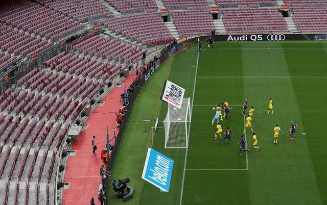 Messi inspires Barca victory at empty Camp Nou