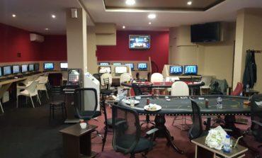 Bases police raid casino, arrest 13
