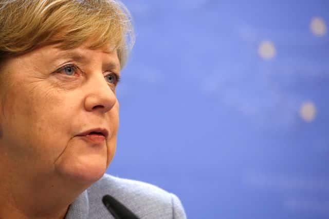 In address, Merkel promises more work on social divisions