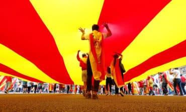 Spaniards use national holiday to show unity amid Catalan crisis