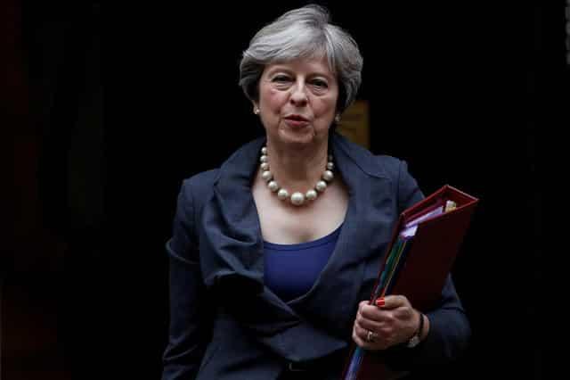 EU mulls Brexit summit gesture, May hints on cash