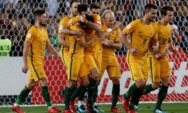 Jedinak hat-trick sends Australia to World Cup