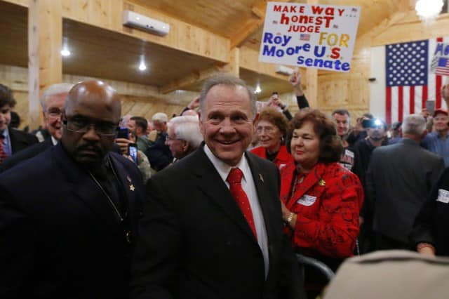 Voters head to polls in Alabama race with high stakes for Trump