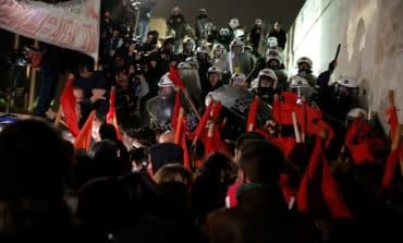 Greek parliament approves bailout reforms despite protests
