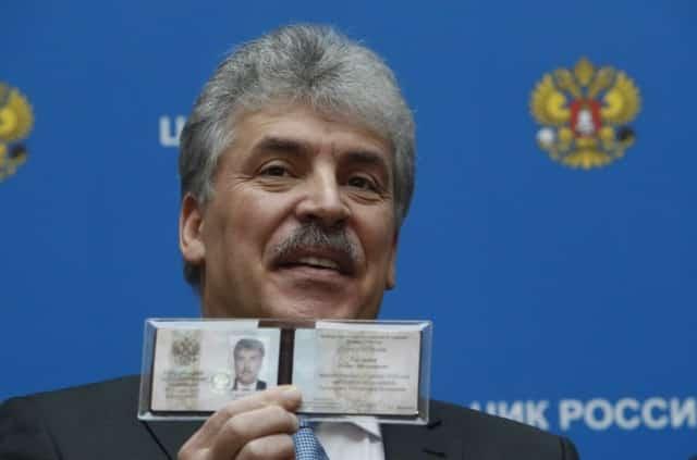 Russian communists register surprise candidate to challenge Putin