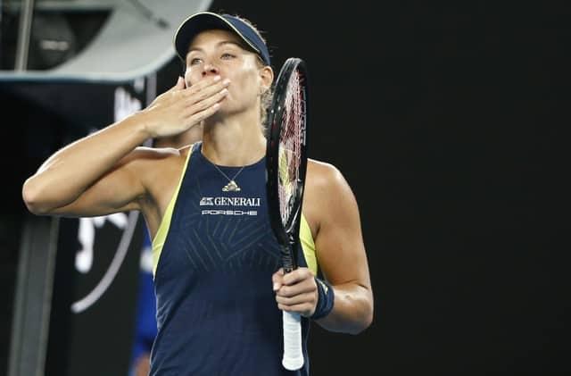 Kerber thrashes Sharapova to reach fourth round