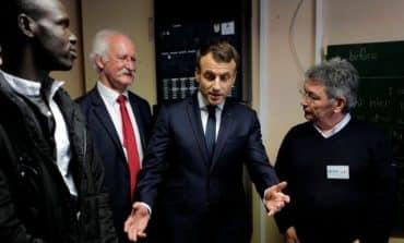 Ahead of UK summit, Macron visits migrants in port of Calais