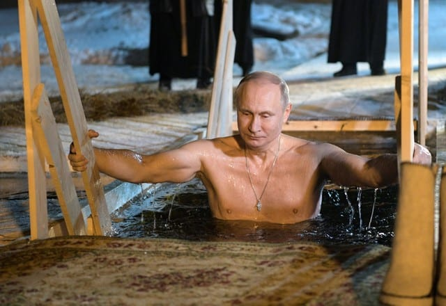Russia's Putin takes dip in icy lake to mark Orthodox Epiphany