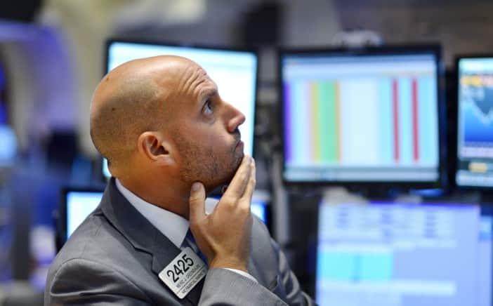 Wall Street gives up 2018 gains amid tech selloff, trade fears