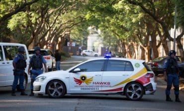 South African police raid Gupta home, ANC to sack Zuma via parliament