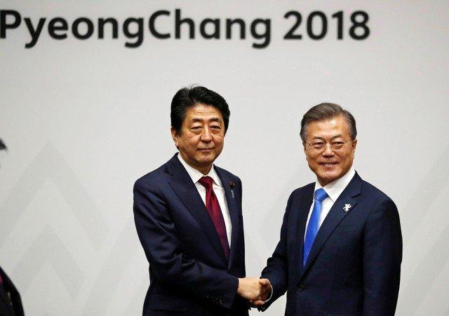 Japan PM tells S. Korea's Moon 2015 'comfort women' deal final