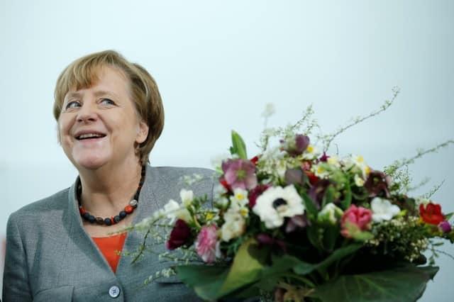 Merkel, SPD under renewed fire over German coalition deal