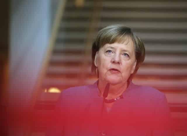 Weakened Merkel hands arch critic a job in German cabinet – source