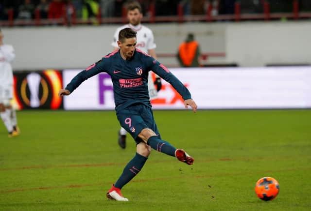 Torres strikes twice as Atletico thrash Lokomotiv
