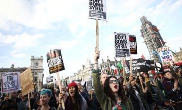 British PM May defends Syria strikes against parliament critics