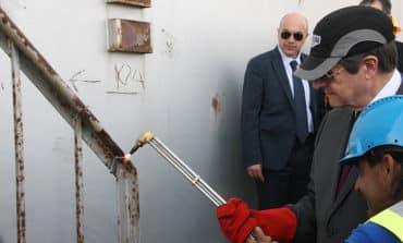 President takes part in 'symbolic' destruction of storage tank