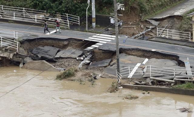 A broken road is seen after heavy rain in Kurashiki