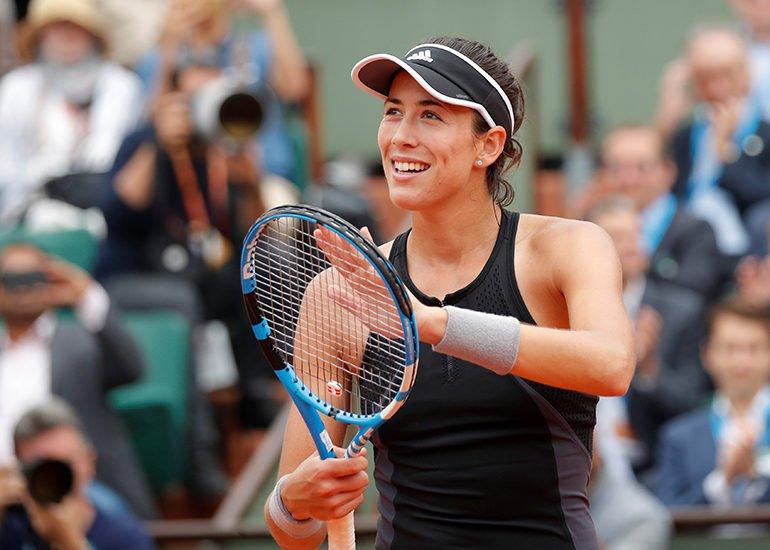 Muguruza thrashes Sharapova to reach semi-finals in Paris
