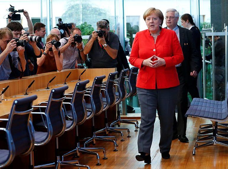 Merkel vows to stay in job, work at 'under pressure' US relationship