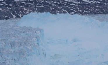 Massive iceberg breaks from Greenland glacier (V)