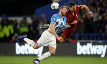 Lucky Liverpool scrape past Huddersfield