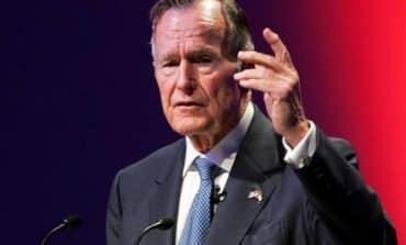 Honour guard as former President Bush begins last trip to Washington