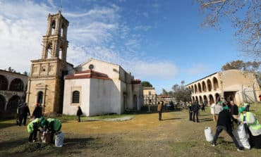 Teams from both sides join forces to clean up vandalised monastery