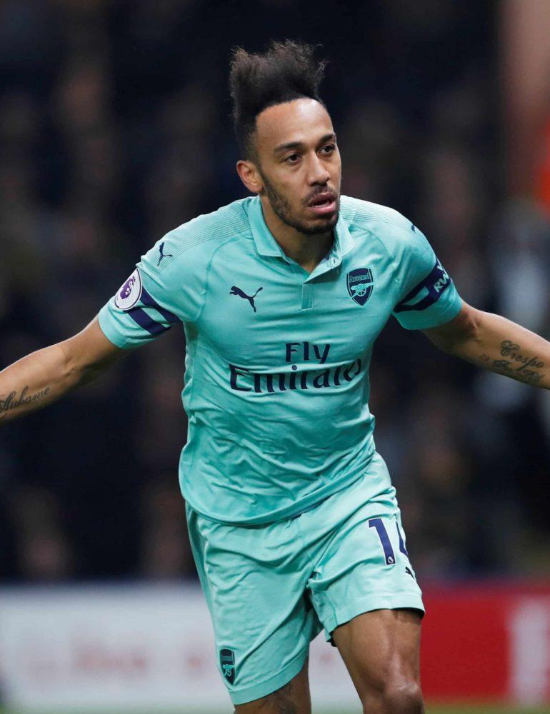 Freakish goal gives Arsenal win at 10-man Watford