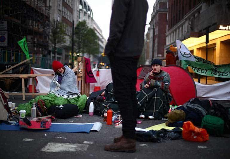 British police arrest 113 climate change activists after London roads blocked