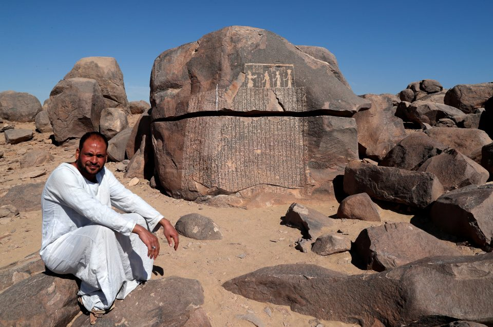 """Hussien, Guard Of Famine Stela, Or """"rock Of Starvation"""", Sits Near The Rock In Aswan"""
