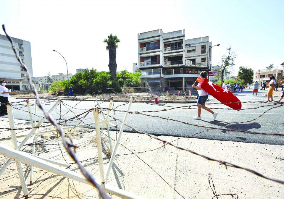 People Walk In The Abandoned Coastal Area Of Varosha