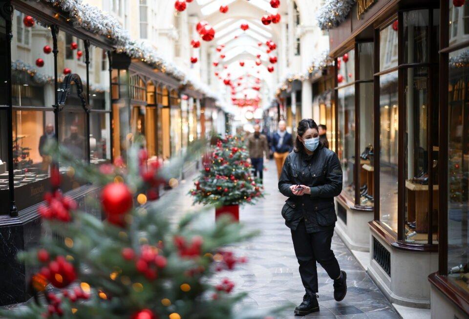 Woman Walks Through The Burlington Arcade Adorned With Christmas Decorations, In London