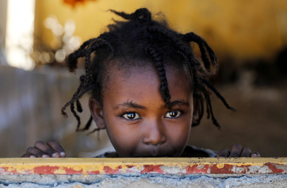 An Ethiopian Girl Stands At The Window Of A Temporary Shelter, At The Village 8 Refugees Transit Camp, Which Houses Ethiopian Refugees Fleeing The Fighting In The Tigray Region, Near The Sudan Ethiopia Border