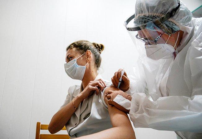 "File Photo: A Medic Of The Regional Hospital Receives Russia's ""sputnik V"" Vaccine Shot Against The Coronavirus Disease (covid 19) In Tver"