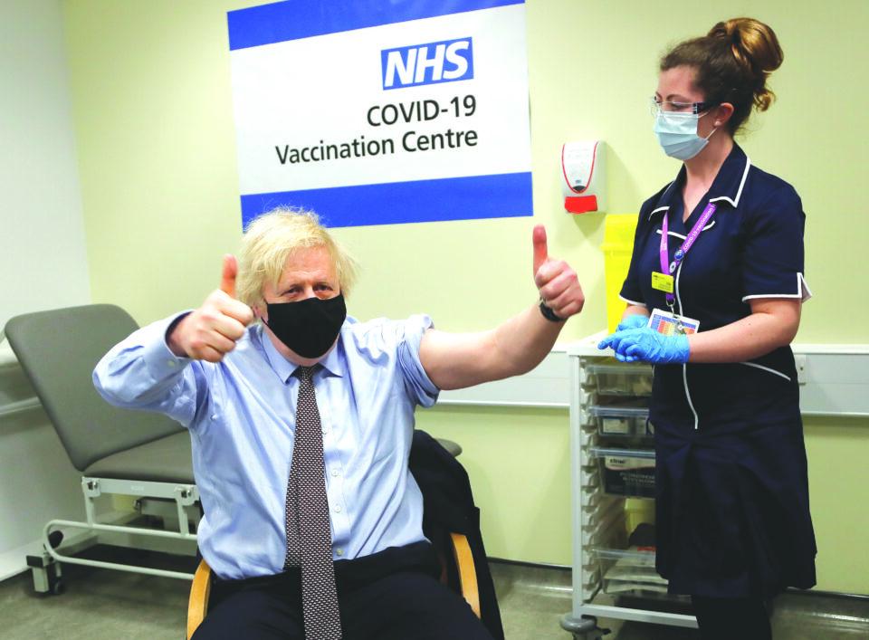 file photo: british prime minister boris johnson receives a dose of the oxford/astrazeneca covid 19 vaccine in london